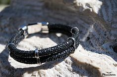 Black Stingray Leather Bracelet 135 USD. Dark and glamorous, this bracelet adds a gorgeous dark sparkle to any outfit and becomes a must-have accessory. #jewelry #leatherbracelet #phantom #stingraybracelet #silver #handcrafted #beautiful #bracelet