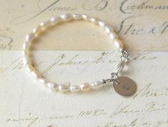 Personalized Ivory Pearl Bracelet Wedding Bridesmaid Flower girl Gift Hand stamped Charm Bracelet on Etsy, $20.00