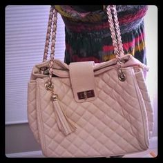 I just added this to my closet on Poshmark: Pastel pink quilted crossbody bag with tassel. Price: $75 Size: OS