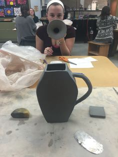added the handle and it's beginning to look more like a pitcher than a coffin