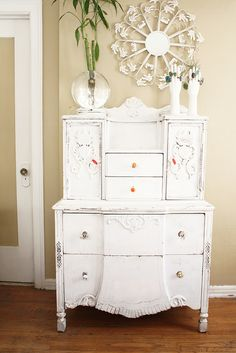 White painted dresser from Jungalow.  Fun, fun site.  Wish I could mix color and pattern like that...