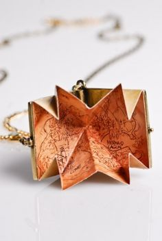 Neverland map pendant!! I'm gonna need this for my future trips there...I always get lost.
