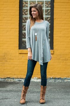 "The name says it all: this tunic is as cute as a button! The gray fabric is fabulous and so soft, and we LOVE the button detailing on the front! This is lightweight, which is perfect for any season and great for layering! Wear it with jeans or leggings and you'll never want to change!   Bra-friendly! Material has fair amount of stretch. Button details.  Small is pictured.   From shoulder to hem:  Small - 28.5""  Medium - 29""  Large - 30"""