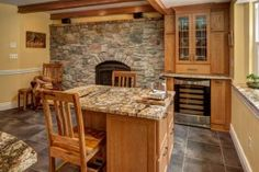Check out this island with room to sit as well as the stone fireplace! Photograph by Andrea Hanks Photography Remodeling Contractors, Home Remodeling, Kitchen Remodeling, Natural Building, Kitchen On A Budget, Simple House, Home Improvement Projects, Decoration, Cool Things To Make