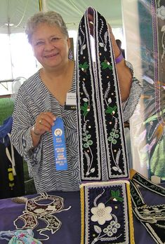 Loretta R. Webster - The bag is 9 X 11 inches oblong with about 12 inch fringes hanging from the bottom. The bandolier strap is 45 inches long so it can fit over the head and across the shoulder. The bag and bandolier are beaded with sizes 8/0, 9/0 and 10/0 glass beads on a deep purple velvet.  They are lined with a lavender wool material. The picture shows the artist winning at the Eiteljorg Indian Art Market, Indianapolis, Indiana 2010. Can be ordered in the color and design you want…