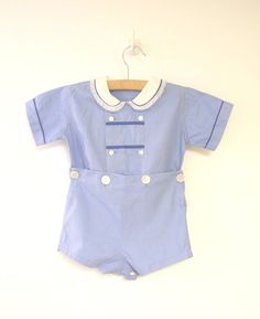 ≈Description≈  This is an adorable sky blue baby boy romper with navy and white accents from the 1950s. The white round collar is trimmed with navy