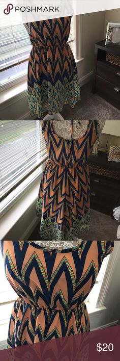 Summer dress. High low. Very different summer dress. Nice back. High low style. Worn once to a bridal shower. I have the belt. Great with wedges or sandals black bead Dresses