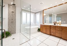 Bathroom glass tile is a top trend for 2018. While clean and simple, the tiling details and patterns are intricate and pleasing.   #customhomes #bathroom #bathroominterior #bathroominteriorideas #interiordesign #interiordesigners #bathroomlove #bathroomideas #bathroomstyle #bathroomtile #bathroomglasstile #glasstile #floortile #simple #clean #vanity #woodvanity #grandvanity #bathroomvanity #style #design #dreamhome #dreambathroom #luxurybathroom #styletips #newtrends #hometrends #bathroomtrends