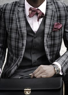 The beauty about a self-tie bow tie, is that it's not supposed to look symmetrical. Sharp!