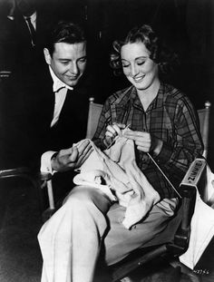 In a pause from filming Words and Music, Tom Drake admires Betty Garrett's knitting