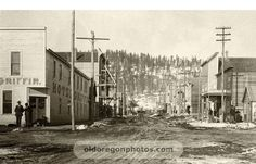 Sumpter, Oregon was a booming gold-mining town at the time this photo was taken. A number of businesses on Mill Street can be identified in this early city view.