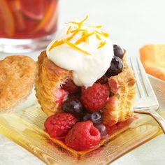 Orange Berries Chantilly Puffs  Orange scented mixed berries are topped with whipped cream and served in a puff pastry shell to make this easy yet elegant dessert. (Could also use creme fraiche?)