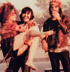"""ATELIER IVAAN: JULY 1970: Ivan Kotulsky carrying Janis in the downtown Winnipeg fountain, w/ Eric Anderson. Ivaan was the photographer for Festival Express. """"Janis was no lightweight, and Ivaan later said he nearly had a heart attack, trying not to drop her."""""""