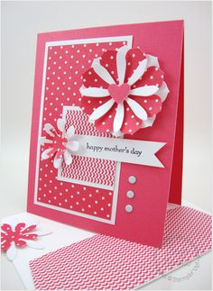 handmade Mother's Day card ... monochromatic rosy red ... luv the panels of printed papers in the exact same colors ... coordinating envelope flap ... layered die cut flowers ... great card! ... Stampin'Up!