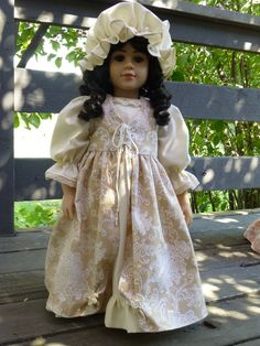 The tan (caramel) version of the 17th century dress.