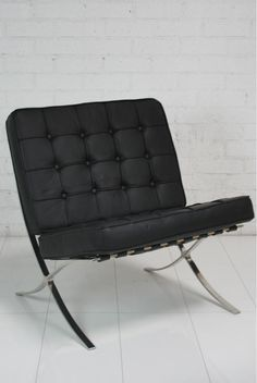 This black tufted chair is sexy. I just called furniture sexy.