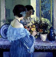 Girl in Blue Arranging Flowers by Frederick Carl Frieseke (USA)