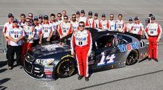 Tony Stewart Photos Photos - Tony Stewart, driver of the #14 Always a Racer/Mobil 1 Chevrolet, poses with his team prior to the NASCAR Sprint Cup Series Ford EcoBoost 400 at Homestead-Miami Speedway on November 20, 2016 in Homestead, Florida. The Ford EcoBoost 400 will mark the end of an 18-year stock car career that has earned the 45-year old three premier series championships and 49 victories. - NASCAR Sprint Cup Series Ford EcoBoost 400