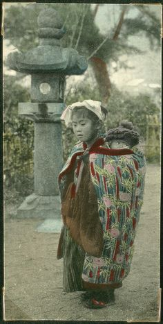 Little girl with a child on her back, Japan.