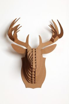 Giant Cardboard Taxidermy. UrbanOutfitters. $34. This would be even better if you print and cut out tribal looking patterns to fit the cardboard pieces.