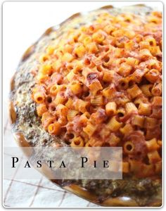 "Superbowl Pasta Pie: ""This is a real comfort dish - this pie has a meatloaf crust and is filled with pasta, cheese and tomato sauce...The whole thing bakes up in the oven and comes out nice and crispy...cut it into wedges and serve with marinara sauce.  It's great on a cold winter's night.""~Blogger"