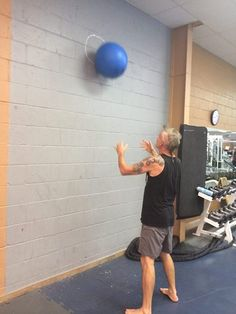 Does this look easy? Try it! Medium Aquafit ball, 2 gallons = 16lbs, 25 reps x 3. Catch it in a low squat. #RobertReifel #Fitness