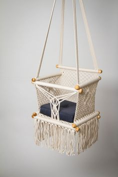 Swing your baby in style with this boho swing chair! Handmade from sustainable wood and fair trade materials, it'll give your little monster endless giggles.  #handmade #baby #babydecor #nursery #sustainable #ecological #ecofriendly #kids #babyswing #swing #swingset #giftsforkids #gifts #lifestyle #parents #mom #mum #fun #playground #babiesofinstagram