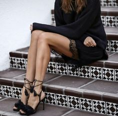 black lace up heels with tassels and black dress