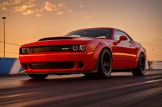 "One look at its muscular body tells you it's not a supercar. Yet the Dodge Challenger SRT Demon is certainly super... something. Powered by a new ""Demon"" variant of the company's supercharged 6.2L Hemi V8, it has 840 hp at..."