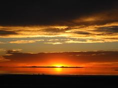 Sunset viewed from the western shore of Antelope Island. Carrington Island is visible in the distance.