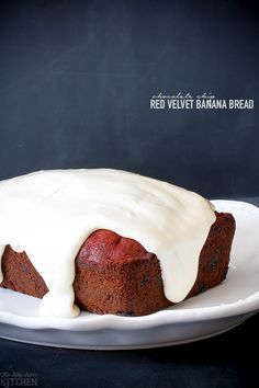 Chocolate Chip Red Velvet Banana Bread, classic banana bread and everyone's favorite cake, red velvet in one! Topped with thick cream cheese icing, swoon. from ThisSillyGirlsKitchen.com #groceryhero