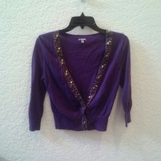 Charlotte Russe Purple Cardigan with Gold Trim Charlotte Russe, size medium purple cardigan in excellent condition. Has 3/4 sleeves, slightly cropped, and gold bead and sequin trim. Three snap buttons at bottom shown in last photo. Please ask any and all questions before purchasing. Thanks! Charlotte Russe Sweaters Cardigans