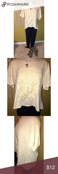 Lace skull top Asymmetrical cream colored tee by Chelsea and Violet with a lace skull sewn onto the front. Shirt is in a size small but runs slightly oversized. I am 5'2 and the shirt sits right at my waste line so it is not as long as it is wide. Make an offer or add to a bundle 💕✨ Chelsea & Violet Tops Tees - Short Sleeve