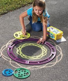 Oooooh my - big spirograph sidewalk chalk mandalas!!!!!  My inner child would love to have this.