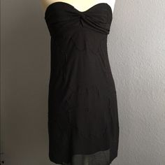 Free People Black Tube Dress Beautiful Free People LBD. Has large flower pattern, attached slip, and knot detail at the chest. It also has an elastic strap on the back to conceal your bra. 30 inches long. Fits size small. No known flaws. Free People Dresses Strapless