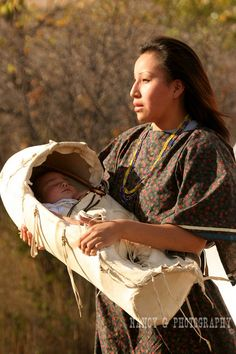 A young Native American Indian women with her infant baby.