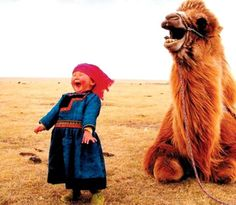 Laughing kids with camels are cute.<<That's very specific, but I agree!