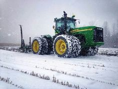 John Deere 9320 ripping in the snow