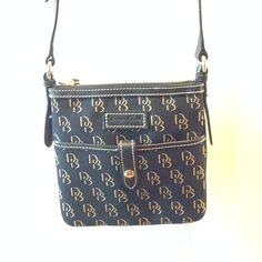 """Dooney & Bourke Signature Crossbody Black Like brand new. Worn a couple of times. No stains, or tears. Excellent condition                One outside pocket One inside zip pocket Cell phone pocket Zipper closure  Dimensions: 8"""" long x 8 1/2"""" tall"""" x 1/2"""" deep"""" Strap drop length: 23"""" - 26 1/2"""" (adjustable) Dooney & Bourke Bags Crossbody Bags"""