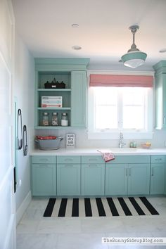 Decorated and Organized Laundry Room (with color!) - The Sunny Side Up Blog