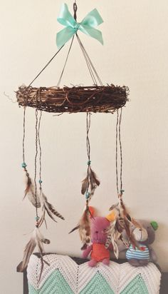 My DIY feather mobile, etsy inspired, for my baby boy's mint arrow themed nursery      (Just started a blog & posted the supplies I used)