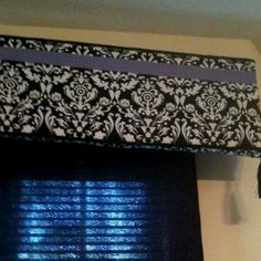 Window cornice made with foam board, fabric and ribbon, attached with hot glue