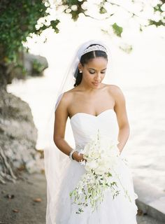 Destination Jamaica - Beautiful Bride with a Gorgeous Orchid Bouquet | See the wedding on SMP: http://www.StyleMePretty.com/2013/01/17/jamaica-destination-wedding-from-bryce-covey-photography/ Bryce Covey Photography