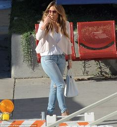 Jennifer Lopez wearing Jimmy Choo Spring 2012 Caged Bootie Hermes Birkin in White