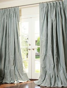 Beautiful silk dupioni curtains. Fabulous color. Want want want!