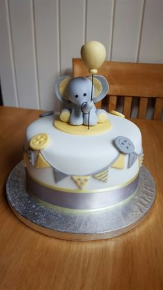 Baby shower, elephant cake, Yellow and grey cake, Bunting and balloon cake …
