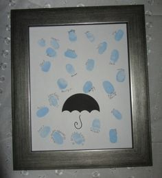 "The ""Guest Book"" - leave their thumb print to form a rainshower theme! The umbrella shape was just cut from cardstock and I drew the handle with a marker."