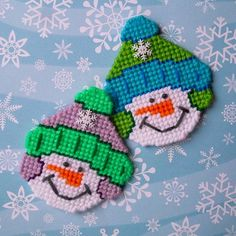 Warm your winter kitchen, magnetic white board or locker with these snugly dressed snow folks. This listing is for 2 snowmen magnets. They are sewn in white, pumpkin, charcoal, turquoise, blue, spring green, paddy green, glow worm, pale plum and dark orchid yarns. A cute snowflake buttons dons the front of their winter hats. Each snowman magnet measures approximately 3 1/2 inches wide and 4 inches high. Two half inch ceramic magnets are on the back of each, for a secure hold to the magn...