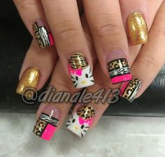 Cute hello kitty nail design with cheetah zebra print.