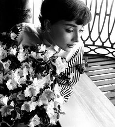 Audrey Hepburn in window with flowers, 1953 by Bob Willoughby